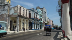 View to old destroyed houses of cental street in Havana city at summer sunny Stock Footage