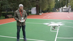 Man operating a drone with remote control. Stock Footage