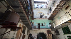 Panoramic view interior of old ragged cuban courtyard with poor houses in Havana Stock Footage