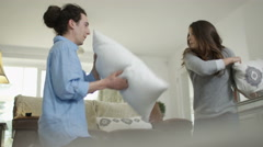 4K Happy couple having a pillow fight & play fighting at home Stock Footage
