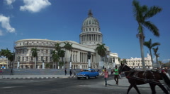 Central street of Havana. View to palms and the Capitol. Tourists, locals, Stock Footage