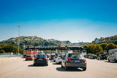 Cars passing through the point of toll highway, toll station Stock Photos