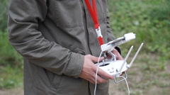 Young man operating a drone remote control console Stock Footage