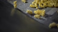 Fusilli pasta passing on a conveyor belt in a pasta factory in Italy. Stock Footage