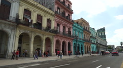 Famous street in Havana of multi-colored houses with big arches. Bright colorful Stock Footage