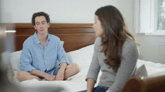 4K Couple with relationship problems having emotional conversation in bedroom Stock Footage