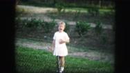 1958: a girl is seen walking inside a house AMES, IOWA Stock Footage