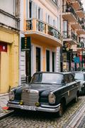 Front View Of Black Rarity Retro Mercedes Benz Car Parked On Nar Stock Photos