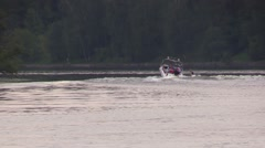 Boat float away and drag behind water-skier by the river Stock Footage