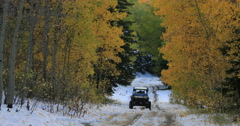 Mountain road snow autumn forest off road vehicle DCI 4K Stock Footage