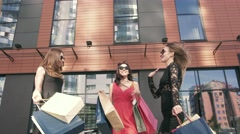 Three attractive female friends meeting after shopping day Stock Footage