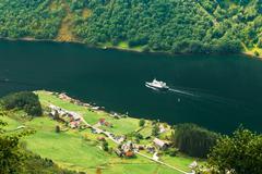 Pleasure Boat Ship Sailing Between Fjords. Village Near Sognefjo Stock Photos