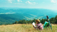 Little hiker child girl 7-8 years using tourist map and sitting on grass Stock Footage
