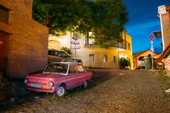 Parked Rarity Tuning Pink Minicar Zaporozhets On Paved Street In Stock Photos