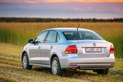 Volkswagen Polo Car Parking On Wheat Field. Sunset Sunrise Drama Stock Photos