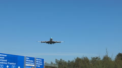 Low-angle view of Airplane approaching the runway of Frankfurt Airport. Stock Footage