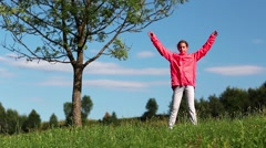 Girl make physical exercises on the nature Stock Footage