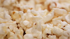 Heap of popcorn in rotation, salty or sweet snack, movie theatre entertainment Stock Footage