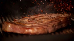 Cooking meat in slow motion Stock Footage