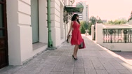 Wonderful brunette spins around with her shopping bags Stock Footage