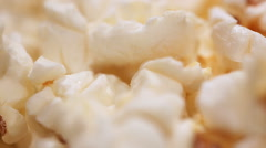 Salty or sweet popcorn closeup, unhealthy popped corn snack served at cinema Stock Footage
