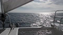 POV style looking foward on catamaran with jib under full sail Stock Footage