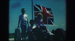 1958: family day out preparing to sing the anthem before we kickoff  Stock Footage