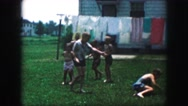 1958: children playing a game out in the yard in the summer time AMES, IOWA Stock Footage