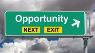 Opportunity Next Exit Highway Sign with Time Lapse Clouds and Zoom Stock Footage