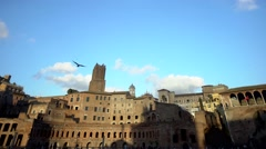 Pan shot of Traiano market in Rome under a blue sky with clouds. Stock Footage