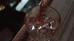 Pouring drink in slow motion Stock Footage