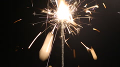 Sparkling bengal light burning in darkness, happy atmosphere at New Year party Stock Footage