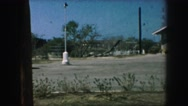 1958: some type of large garage with a vast parking lot AMES, IOWA Stock Footage