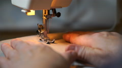 Footage of woman sews on the sewing machine. 4K Stock Footage