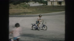 1958: little boy trying out his brand new bicycle in the front driveway. AMES Stock Footage