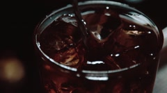 Mixing alcohol with ice in slow motion Stock Footage