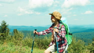 Little hiker girl 7-8 years in sunglasses standing on mountains background Stock Footage