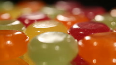Colorful sweet candies moving on production line, confectionery plant, industry Stock Footage
