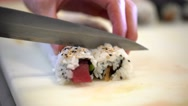 Closeup of chef's hands cutting with a knife sushi. Stock Footage