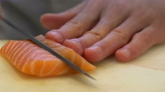 Macro shot of slicing salmon with a sharp knife. Stock Footage