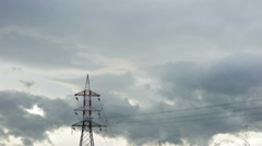 Upper part of a pylon standing out against a cloudy sky. Time lapse. Stock Footage