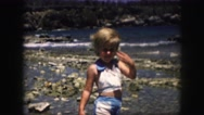 1958: little girl playing at the beach AMES, IOWA Stock Footage