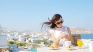 Beautiful girl taking selfie on breakfast with phone at outdoor cafe with Stock Footage