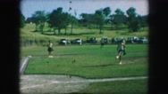 1958: women players are practicing baseball in the grassy ground AMES, IOWA Stock Footage