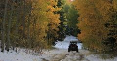Mountain road snow autumn forest recreation off road DCI 4K Stock Footage