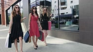Group of young beautiful females walking elegantly downtown Stock Footage