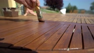 Macro shot of restorer restoring a wooden table varnishing with a mordant. Stock Footage