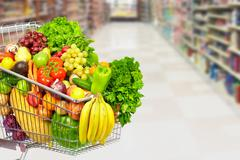 Grocery shopping cart with vegetables. Kuvituskuvat
