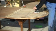 Restoring a wooden table with an electric plane. Garden furniture. Stock Footage