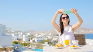 Woman taking photo of breakfast using mobile smart phone. Girl taking pictures Stock Footage